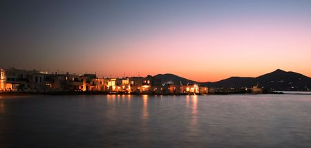 View of the town of Naoussa at night on Paros Island, famous for its night life and cosmopolitan crowd - Greece