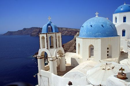 Traditional greek orthodox church from thew town of Oia, Santorini - Greece Stock Photo