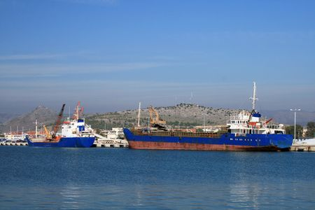 nauplio: Two old cargo ships loading at the harbor of Nauplio, Greece