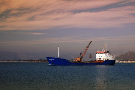 nauplio: Cargo ship with loaded crane - Nauplio, Greece
