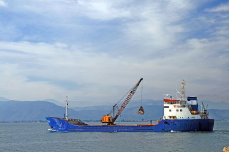 nauplio: Cargo ship with  crane - Nauplio, Greece