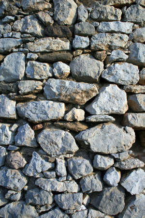 fortification: Detail from a stone fortification wall - background