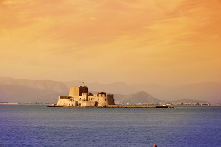 nauplio: Fort Bourtzi protecting the entrance to the harbor of Nauplio, the old capital of Greece Stock Photo