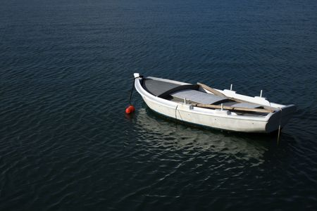 nauplio: A small single fishing boat with oars - Nauplio, Greece Stock Photo