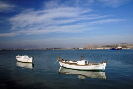 nauplio: A pair of traditional greek fishing boats at the harbor of Nauplio, Greece
