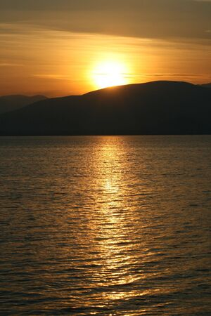 nauplio: A warm fall sunset over the coast of Nauplio, Greece Stock Photo