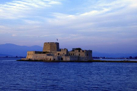 nauplio: Sunset photo of Fort Bourtzi protecting the entrance to the harbor of Nauplio, the old capital of Greece