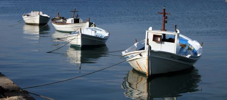 nauplio: Traditional greek fishing boats tied at the pier  - Nauplio, Greece Stock Photo