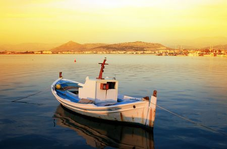 nauplio: Traditional greek fishing boat with view of the town of Nauplio, Greece Stock Photo