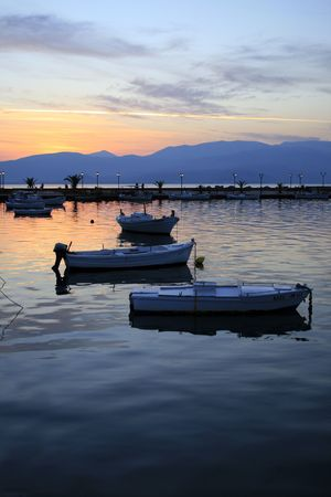 nauplio: Fishing boats silhouettes against setting sun - Nauplio, Greece