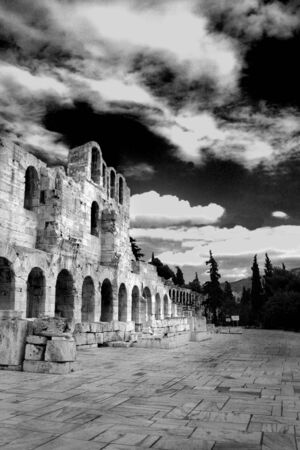 Athens, Greece - View of the ancient Herodus Atticus theatre under the acropolis.  Black and white photo photo