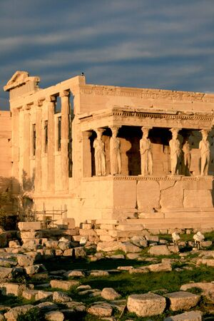 caryatids: Athens, Greece - View of the Erechtheum, temple on the north side of the Acropolis dedicated to Athena and Poseidon. Note the Caryatids, female figure sculptures supporting part of the roof.