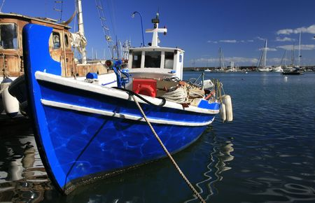 marina life: Athens, Greece. Traditional greek fishing boats at the harbor of Mikrolimano  Stock Photo