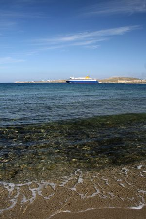 View from the beach of a ferry boat departing.  Paros Island, Greece Stock Photo - 2801060