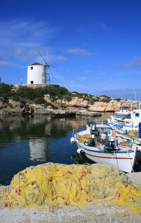 A traditional greek fishing boat at the old harbor of Paroikia.  Paros Island, Greece
