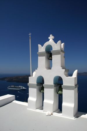 Santorini island.  View of a church belltower from the town of Fyra (Fira) built on the volcanic cliffs of the island. Greece Stock Photo - 2811555
