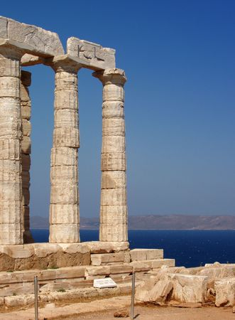 Greece, Sounio - The temple of Poseidon at cape Sounio, south of Athens.  Legend has it that Cape Sounion is the spot where Aegeus, king of Athens, leapt to his death off the cliff, thus giving his name to the Aegean Sea. photo