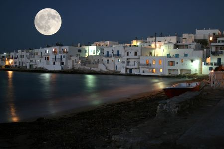 Paros island by night and moonlight.  View of the town of Naoussa