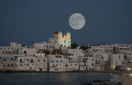 archtecture: The town of Naoussa on the island of Paros, Greece,  early in the evening as the moon is rising.