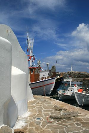 archtecture: Paros, Greece: church and fishing boats from the old harbor of the town of Naoussa Stock Photo
