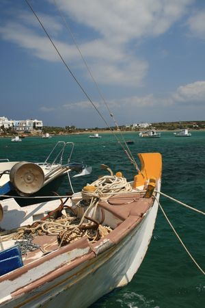 Greek island of Antiparos - Traditional greek fishing boats at the harbor of Antiparos island photo