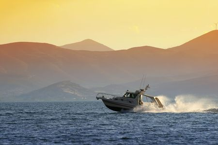 nauplio: Small luxury yacht speeding away from Nauplio, Greece