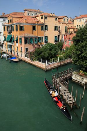 Gondola and villa on the Grand Canal of Venice, Italy photo