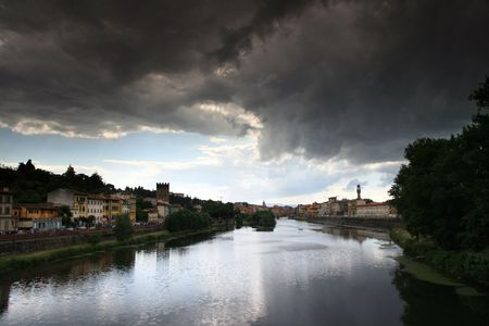 View of  the Arno river with storm clouds in Florence, Italy
