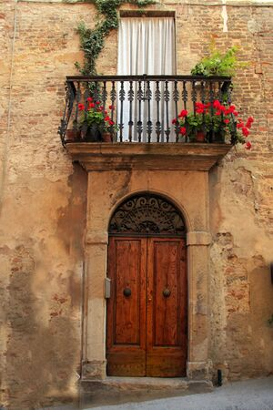 Tuscany. Typical home entrance and balcony of a home in Tuscany Stock Photo