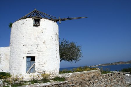 Windmill at the popular island of Paros, Greece