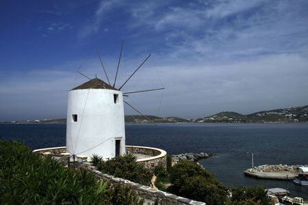 Greece, whitewashed windmill at the island of Paros. photo