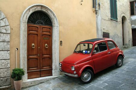 Italy car at the town of Montepulciano in Italy in a typical narrow street photo