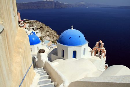 Greek island of Santorini.  View of the town of Oia built on the volcanic cliffs of the island. Greece