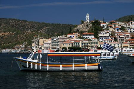 View of Poros island, Greece and boats