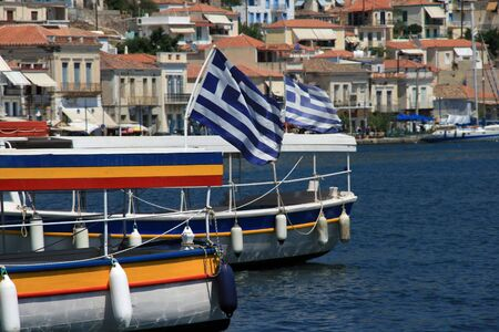 View of boats with Greek flags from the island of Poros, Greece