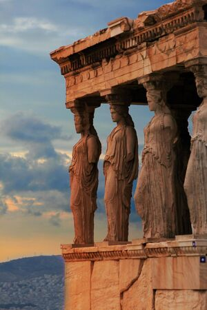 The Karyatids of the Acropolis with the city of Athens, Greece in the bacground Stock Photo