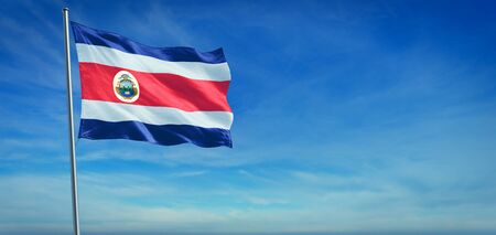 The National flag of Costa Rica blowing in the wind in front of a clear blue sky