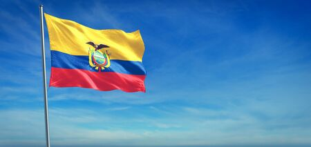The National flag of Ecuador blowing in the wind in front of a clear blue sky