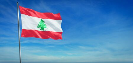 The National flag of Lebanon blowing in the wind in front of a clear blue sky