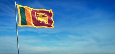 The National flag of Sri Lanka blowing in the wind in front of a clear blue sky Foto de archivo