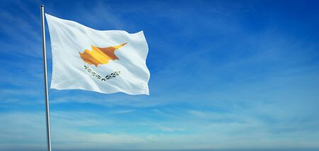 The National flag of Cyprus blowing in the wind in front of a clear blue sky