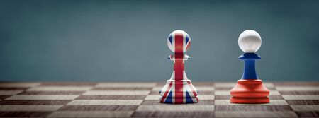 UK and Russia conflict. Country flags on chess pawns on a chess board. 3D illustration. Archivio Fotografico