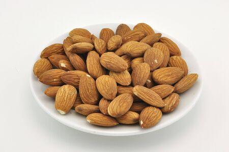 Almond on white plate photo