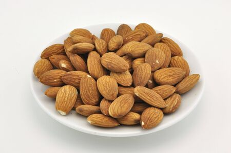 Almond on white plate