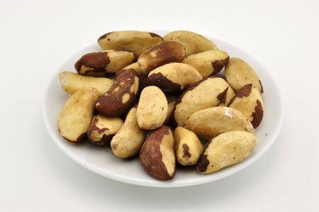 Brazilian nuts on white plate