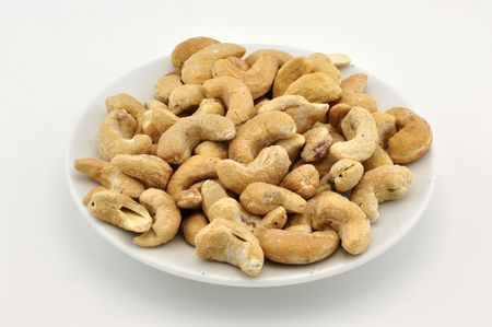 Cashew nuts on white plate