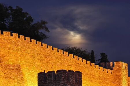 Night shot of a illuminated wall of medieval fortress Kale, Skopje Stock Photo