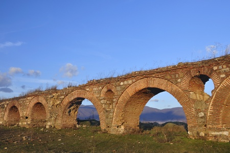 the remains of an old roman aqueduct near city of Skopje Stock Photo