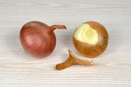 A coople of onion cloves on table Stock Photo