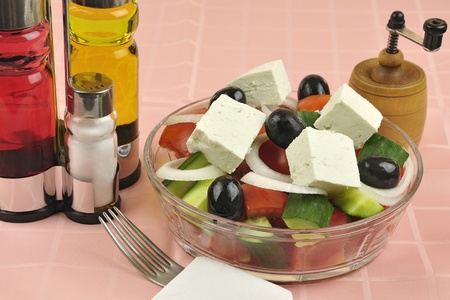 Greek mixed salad with fresh vegetable in glass plate
